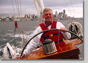 Charles Fawcett, artist, at the helm of the yawl Carlin, in Seattle